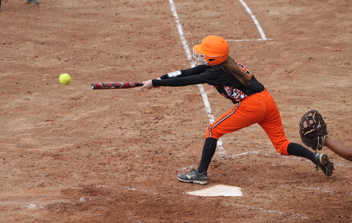 Trojans get out of Allegan with a win after softball doubleheader
